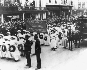 June 1913, London, England, UK --- Suffragettes in white uniform form part of the procession at the funeral of militant campaigner Emily Davison who died making a protest at the 1913 Epsom Derby, when she threw herself in front of King George V's horse. --- Image by © Hulton-Deutsch Collection/CORBIS