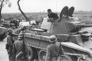 German soldiers meet Russian Soldiers in a T34 Tank.  In roughly two years' time they would be fighting each other and the T34 would be one of the reasons for Russia's eventual victory.